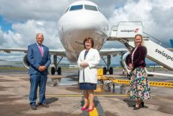 Economy Minister Diane Dodds (centre) at George Best Belfast City Airport with (from left) Chief Executive Brian Ambrose and Commercial Director Katy Best.