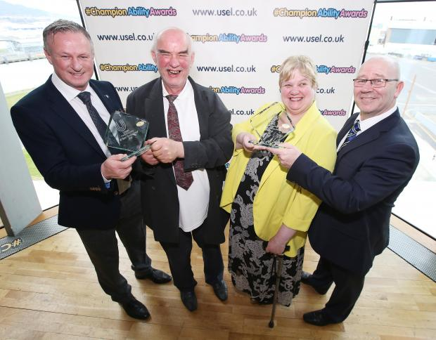 Michael O'Neill (NI Football Manager) and Bill Atkinson (CEO of Usel) with two of the winners