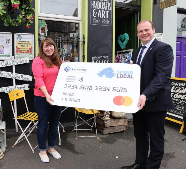 Sinead McCann, Director Danann Crafts Ltd in Lurgan pictured with Economy Minister Gordon Lyons during the Minister's recent visit to the town to highlight the High Street Scheme.