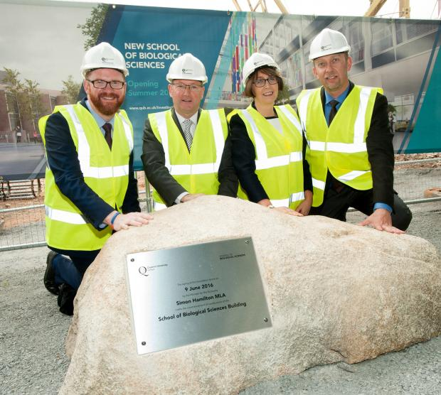 Hamilton helps unveil the foundation stone at new Queen's School of Biological Sciences