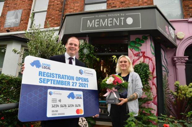 Economy Minister Gordon Lyons pictured with Milana Surova of Memento florists on the Ormeau Road, Belfast.