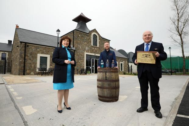 Economy Minister Diane Dodds, Head Distiller at Hinch Aaron Flaherty and owner Dr Terry Cross OBE.