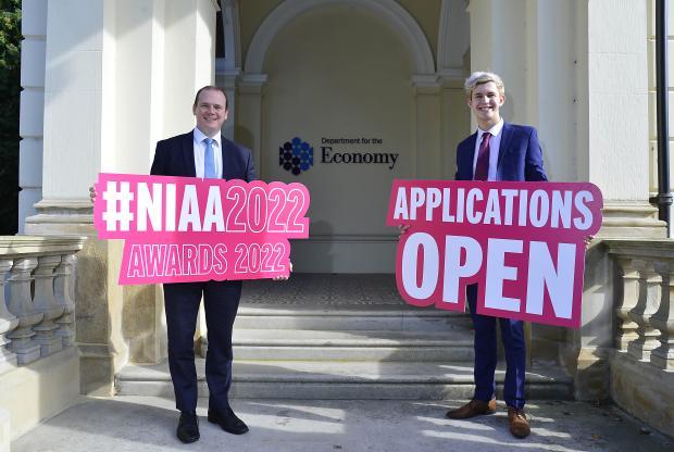 Economy Minister Gordon Lyons with James Matchett, Higher Level Apprentice of the Year 2021
