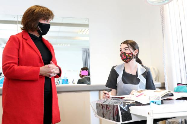 Diane Dodds speaks to beauty student Chloe McDowell at Northern Regional College's Newtownabbey Campus