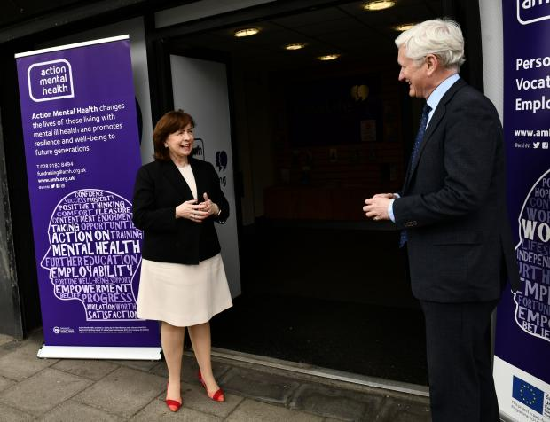 Economy Minister with David Babington from Action Mental Health on a visit to their Belfast premises.