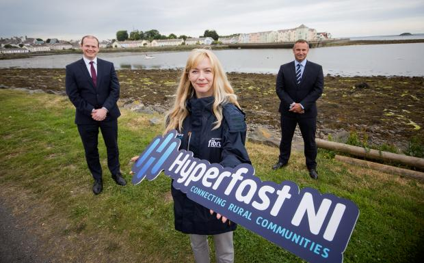 Economy Minister Gordon Lyons, Fibre Ambassador Griana Fox, and Fibrus Networks' Hyperfast NI Programme and Commercial Director, Shane Haslem.
