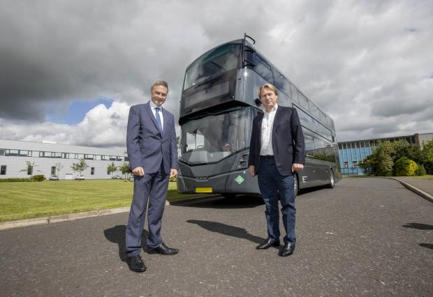 Economy Minister Paul Frew pictured with Jo Bamford, owner of Bamford Bus Company.