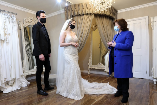 Economy Minister (right) joins bride-to-be Christine van Schalkwyk at Orchard Bridal Shop while shop owner Neil Anderson looks on