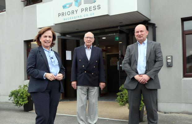 Pictured with Diane Dodds at Priory Press Packaging in Conlig are (centre) Ernest McConville, Chairman, Priory Press Packaging, and Mark McConville, Managing Director of the company.