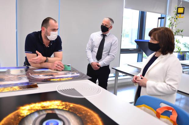 Economy Minister Diane Dodds chats with SRC student Borza Tomas (left) and Curriculum Area Manager Chris Hobson during a tour of Southern Regional College's new £15million Banbridge campus.