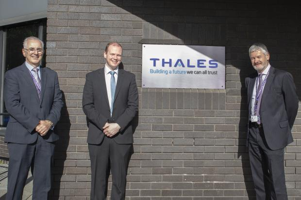 Economy Minister Gordon Lyons (centre) withPhilip McBride, Managing Director,and David Gilleece, Operations Director, Thales Belfast.