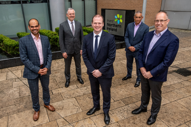 Pictured with Economy Minister Gordon Lyons (centre) are from left Thomas Raju, Belfast Site Lead, Agio; Kevin Holland, CEO, Invest NI; Ray Hillen, Managing Director - Cybersecurity, Agio and Garvin McKee, Chief Revenue Officer, Agio.