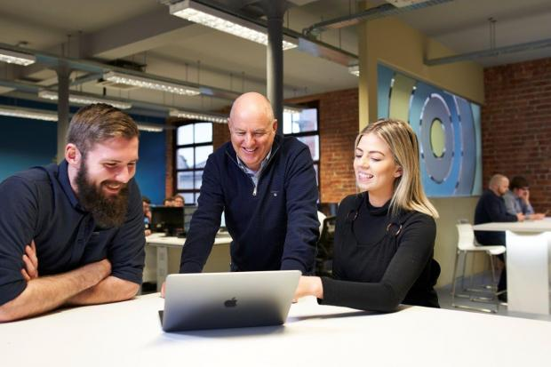 John Harkin (middle), Founder and Director of Alchemy Technology Services, with successful recruits from the company's first Academy, Technical Analyst Jordan Cairns and PMO Analyst Olivia Skuce