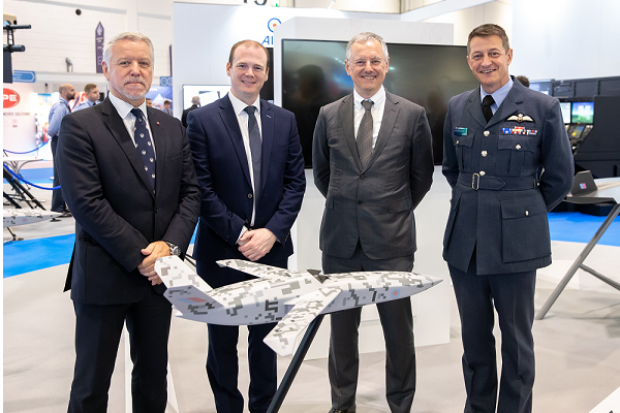 Pictured with a model of the Mosquito at RAF stand at the DSEI exhibition in London are (l-r) Nick Laird of Spirit AeroSystems; Economy Minister Gordon Lyons; Kevin Holland, CEO, Invest NI; and Cab Townsend of the RAF.